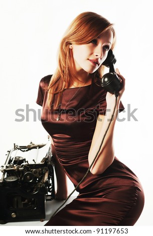 Young woman calling on the retro phone - stock photo