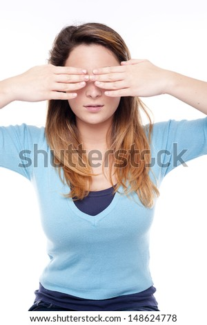 Young woman can't see on white background - stock photo