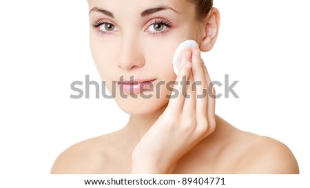 young woman cares for face skin - stock photo