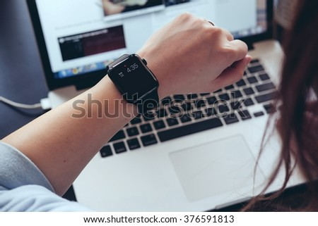Young woman checking her smart watch