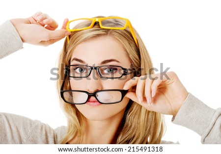Young woman checking new  eyeglasses - stock photo