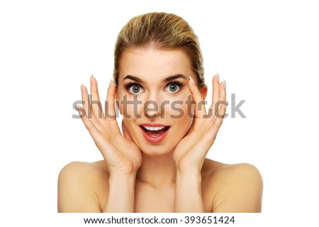 Young woman checking wrinkles on her forehead - stock photo