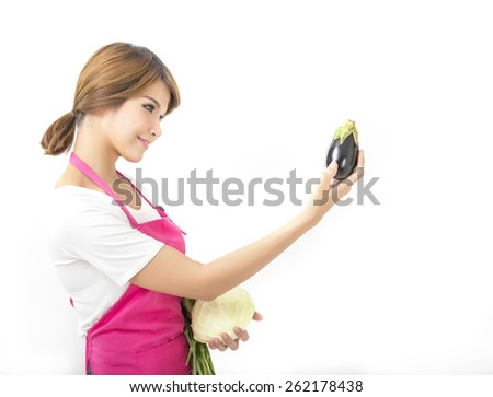 Young woman chef cooking - stock photo