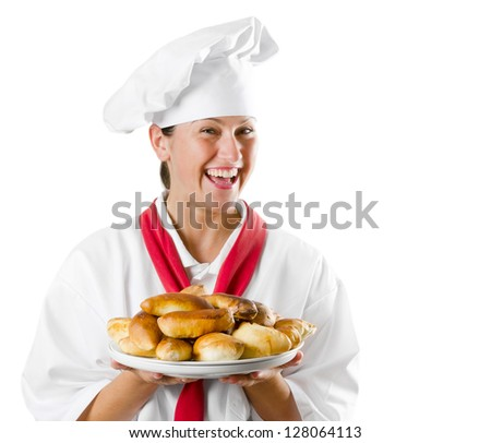 Young woman chef holding a plate with pies isolated on white