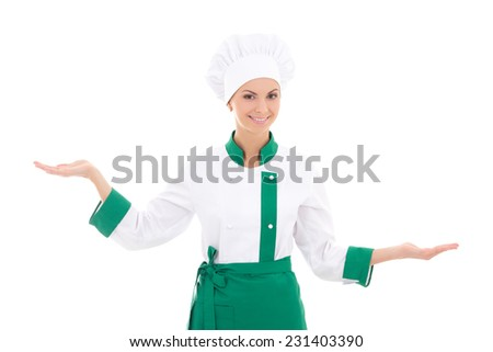 young woman chef holding, showing or presenting something isolated on white background - stock photo