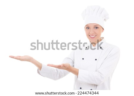 young woman chef showing or presenting something isolated on white background - stock photo