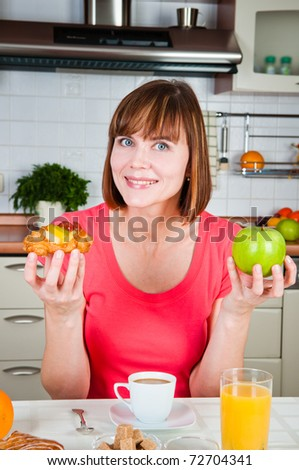 Young woman chooses healthy diet - stock photo