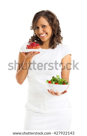 Young woman choosing sweets or healthy eating - one portion of cake and a healthy salad