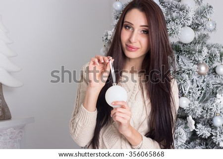 Young woman. Christmas. Christmas tree. New Year. Holidays.