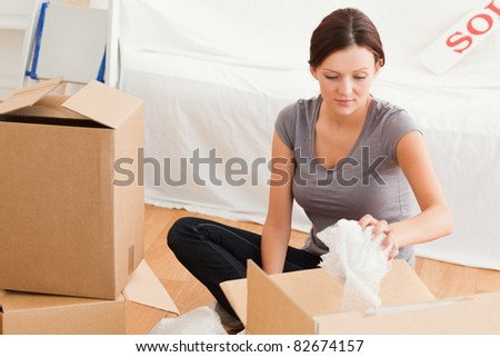 Young woman clearing out her former home - stock photo
