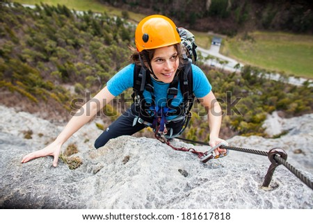 Young woman climber  having fun - stock photo