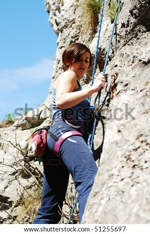 young woman climbing - stock photo