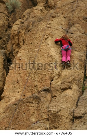 Young woman climbing, pink outfit, 		Smith Rock State Park, 	Central Oregon