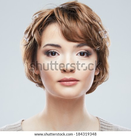 Young woman close up face beauty portrait.Short Hair style. Female model isolated white background.