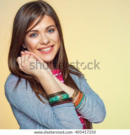 Young woman close up face portrait. Yellow isolated.Toothy smile teenager style portrait. - stock photo