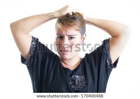 Young woman combing her hair with your hands on white background