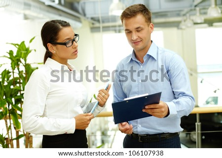 Young woman considering the business proposition made by her partner - stock photo