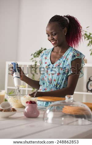 Young Woman Cooking at home. Healthy Food. Dessert Concept. Healthy Lifestyle. Cooking At Home. Prepare Food