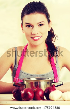 Young woman cooking healthy food at kitchen  - stock photo