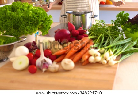Young Woman Cooking in the kitchen. Healthy Food - stock photo
