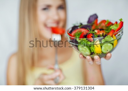 Young Woman Cooking in the kitchen. Healthy Food - Vegetable Salad. Diet. Dieting Concept. Healthy Lifestyle. Cooking At Home. Prepare Food  - stock photo