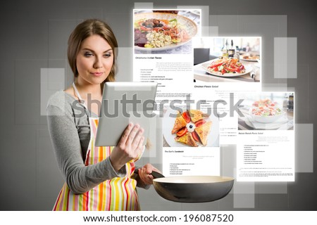 young woman cooking using the tablet, cloud of colorful social media icons out of tablet pc - stock photo