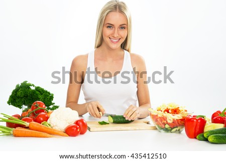 Young woman cooking  vegetable salad - stock photo