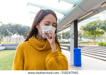 Young Woman coughing - stock photo