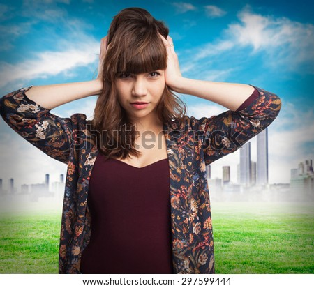 young woman covering her ears - stock photo