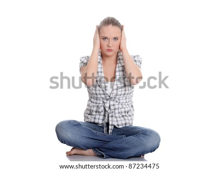 Young woman covering her ears, isolated on white - stock photo