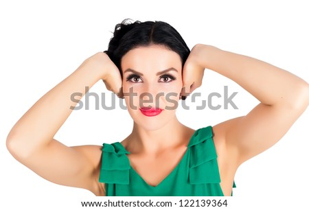 Young woman covering her ears with hands on white background - stock photo