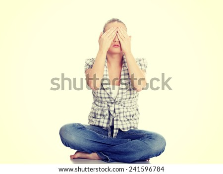 Young woman covering her eyes. - stock photo