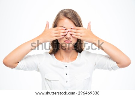 Young woman covering her eyes isolated on a white background - stock photo