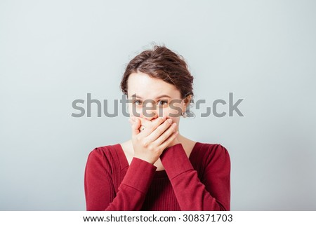 young woman covering the face with her hands