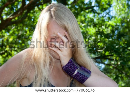 Young woman cries - stock photo
