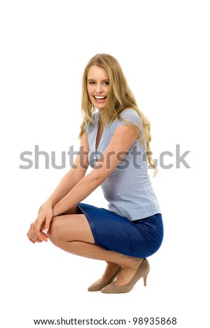 Young woman crouching - stock photo