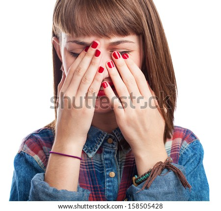 young woman crying and covering her face on white - stock photo