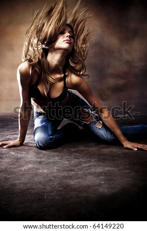 young woman dance on the floor, studio shot - stock photo