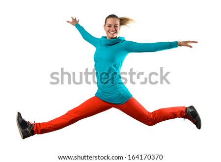 Young woman dancer jumping isolated on white - stock photo