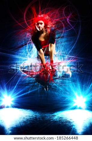 Young woman dancer jumping. With special light effects. - stock photo