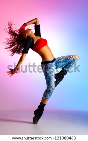 Young woman dancer. On blue and pink background.