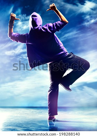 Young woman dancer. On sky background. - stock photo