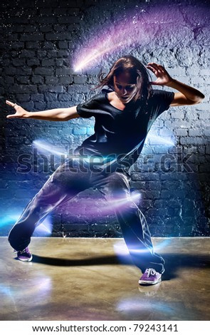 Young woman dancer. With lights effect. - stock photo