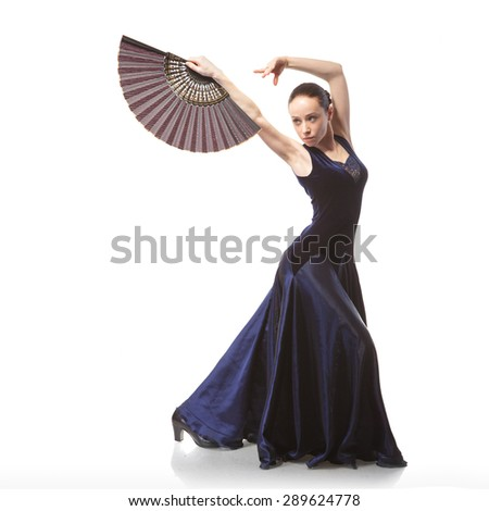young woman dancing flamenco in blue dress with fan isolated on white background - stock photo