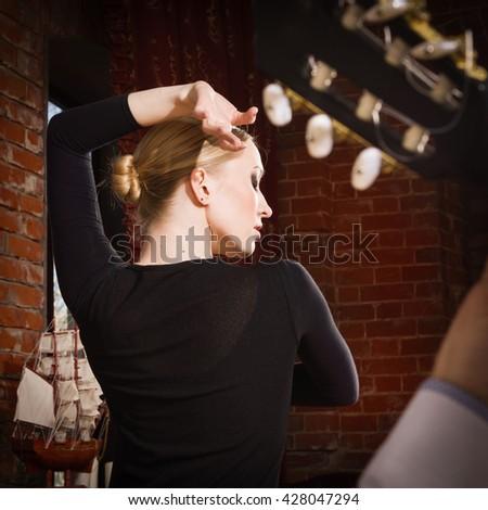 Young woman dancing flamenco in traditional flamenco dress - stock photo