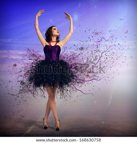 Young woman dancing for her abstract background - stock photo