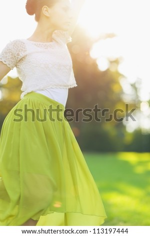 Young woman dancing on forest - stock photo