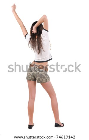 Young woman dancing. Rear view. Isolated over white.