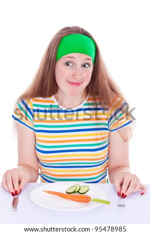 Young woman decide to eat vegetables - stock photo
