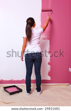rain and dust protection young woman decorating the wall in her new home